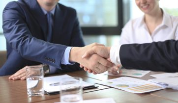 an employee of the company finalize a contract with a client