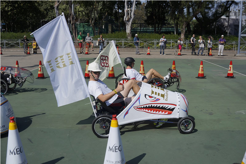 a man is ridding a pedal kart sponsored by ibi